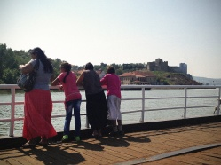 passengers. Turkish fort in the background